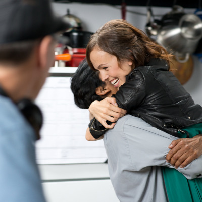 Hugging it out on set